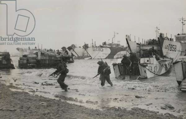 Liberation of Europe: Commandos pour into beachheads, fight their way inland, 1944 (b/w photo)