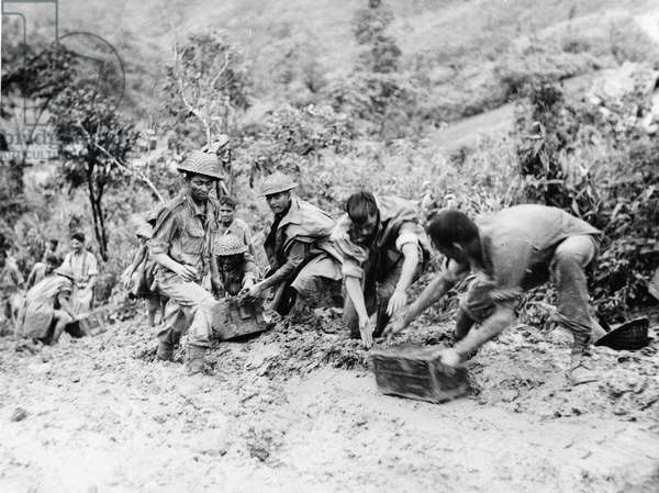 Manhandling of ammunition on the Tamu Road, from a collection of 48 photographs relating to the Burma Campaign (1941-45) during World War Two, 1944 (b/w photo)