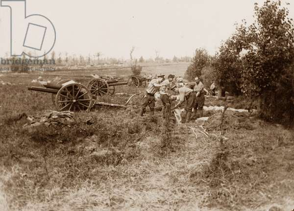 Gunners dig in on captured territory during the Battle of Messines Ridge, 1917 (b/w photo)