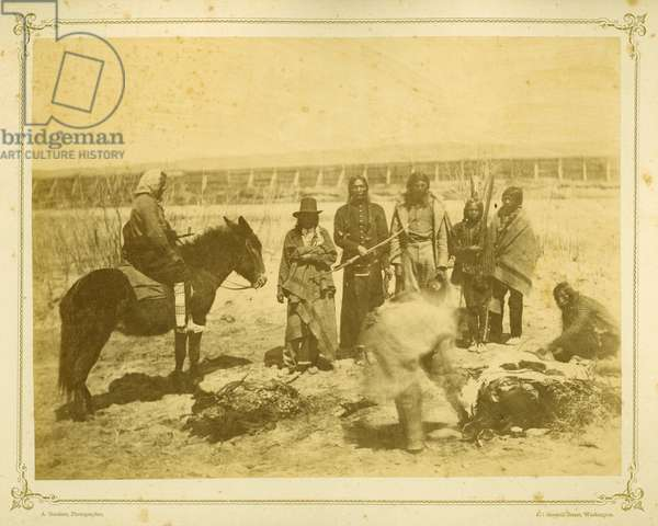 Indians killing and cutting up a steer, 1868 (albumen print)