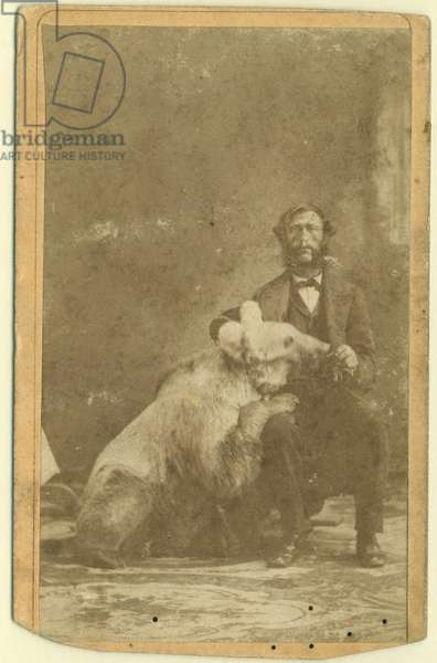 James Capen 'Grizzly' Adams (1807-60) photographed with a Grizzly Bear (b/w photo)