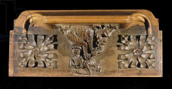 A misericord depicting a small capped figure pounced on by a monster, New College Chapel, Oxford, late 14th century (wood)