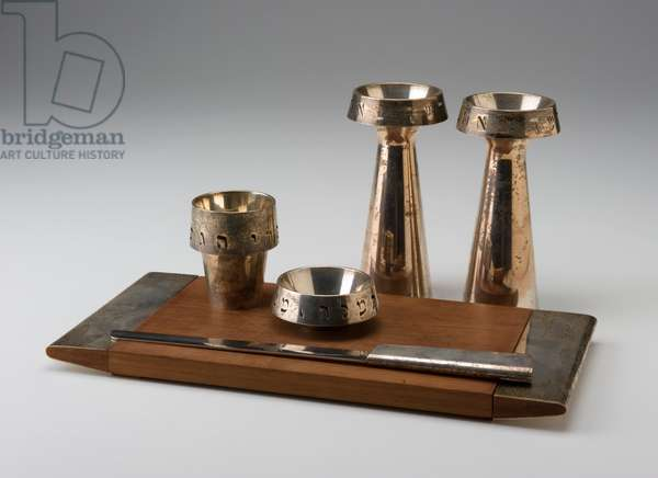 Sabbath Set: two candlesticks, Kiddush cup, salt dish, bread knife, Hallah tray, designed 1963 (Knife: steel, walnut, and silver; Candlesticks, cup, and dish: silver: fabricated and pierced; Tray: walnut and silver)