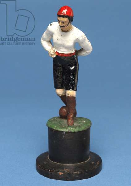Footballer with the ball at his feet (hand-painted metal)