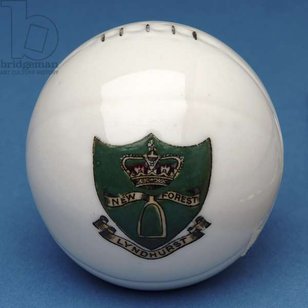 Armorial souvenir miniature football with transfer of the Lyndhurst, New Forest crest (ceramic)