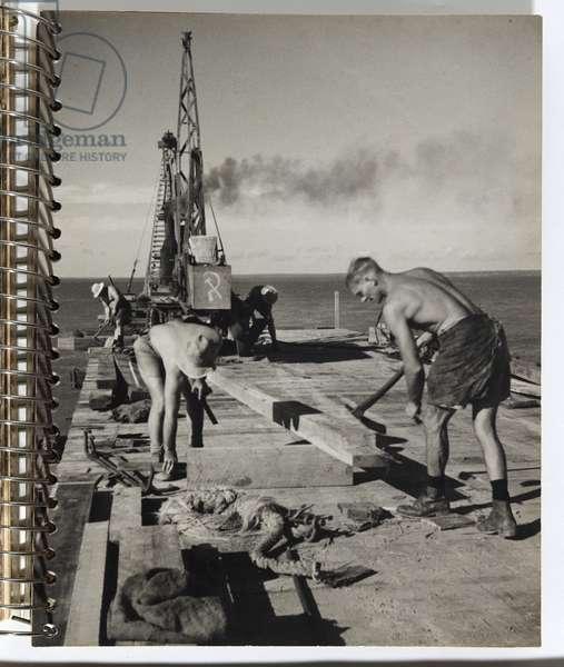 Men working on jetty, 1942-44 (gelatin silver photo)