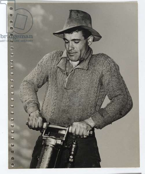 Man in jumper with drill, 1942-44 (gelatin silver photo)