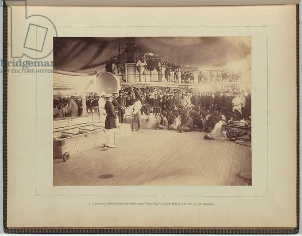 Commodore shaking hands with native chief 'Boe Vagi', on board H.M.S. Nelson, Port Moresby, 1884 (albumen silver photo)