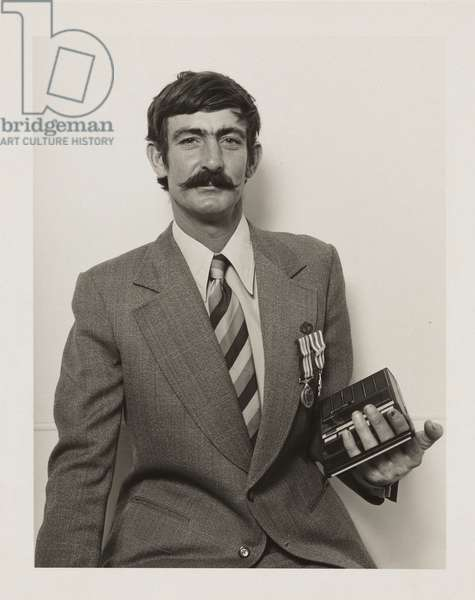 RSL Secretary Ted Davies holds the Wilcannia Anzac Day Marching Band tape recorder, 1982 (gelatin silver photo)