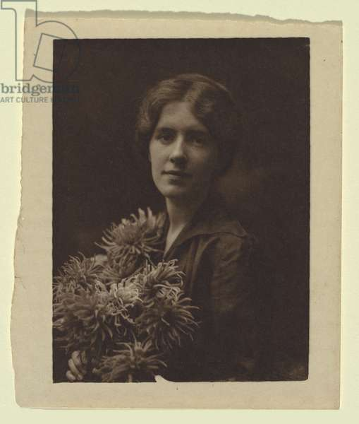 Portrait of a woman holding a bunch of dahlias, 1905-15 (gelatin paper print on sepia)