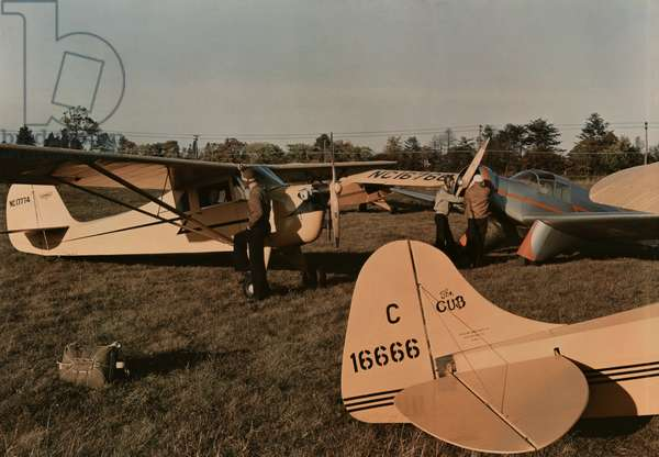 Pilots inspect their planes at the Congressional Airport, Maryland, 1937 (autochrome)