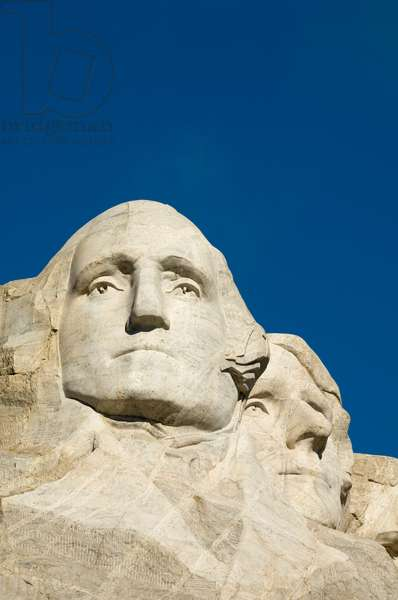 Low angle view of presidents George Washington and Thomas Jefferson's sculptures on Mount Rushmore (photo)