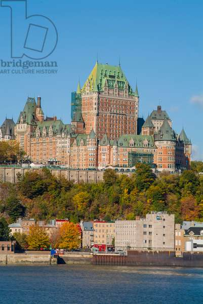 The iconic Chateau Frontenac and old city ramparts dominate the skyline of Quebec City as seen from the Saint Lawrence River below
