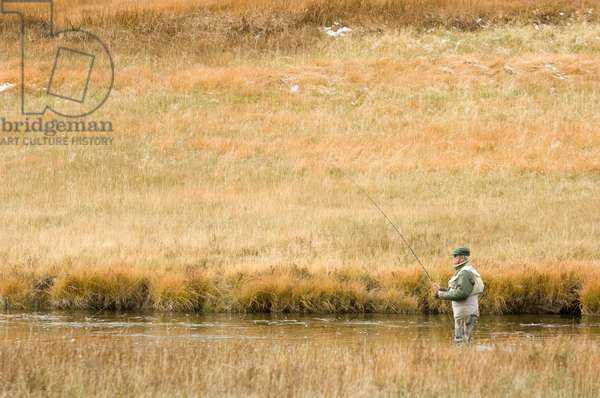 A man fishing in the Firehole River (photo)