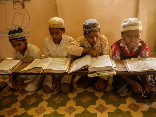 Muslim boys study the Islamic religion at an orphanage school in the village of Napa where Mahatma Ghandi passed through during his Salt March (photo)