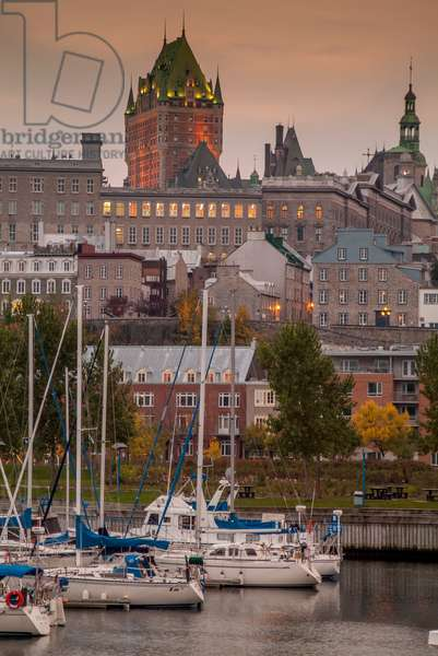 The iconic Chateau Frontenac dominates the skyline of Quebec City as seen from the harbor