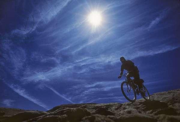 A mountain biker on Slickrock Trail near Moab, Utah (photo)
