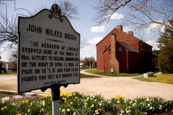 The John Wilkes Booth historical marker at the Surratt House Museum (photo)