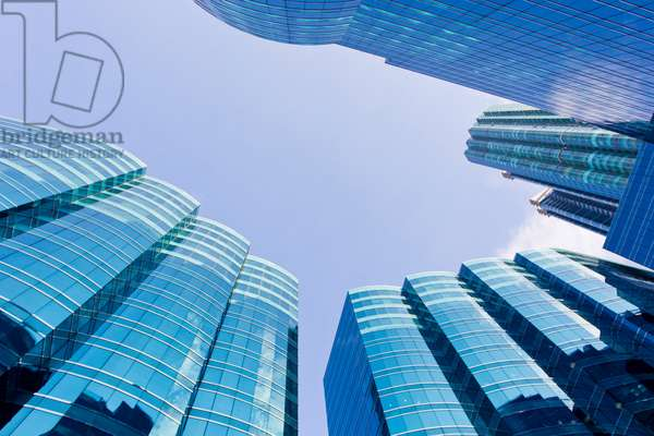 Looking straight up at the Harbor Grand glass buildings in the Kowloon district (photo)