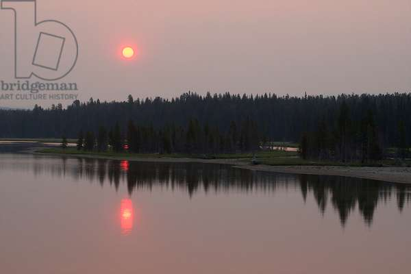 A pink sun rises over the Yellowstone River