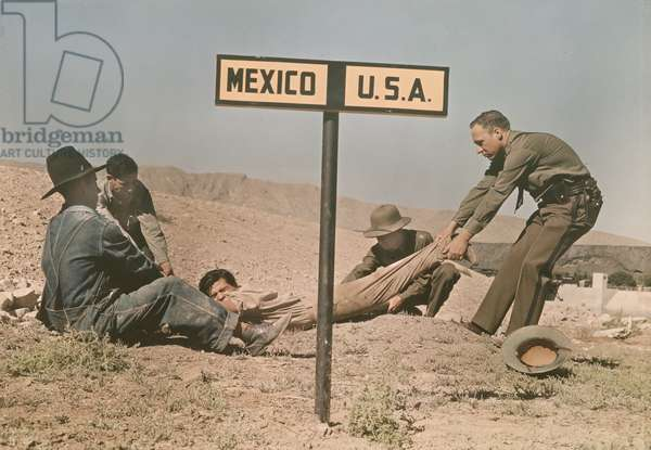 Two border patrol officer attempt to keep a fugitive in the US, International Border, near El Paso, Texas, 1939 (autochrome)