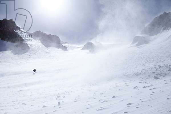 A mountain climber making his way up a snowy slope (photo)