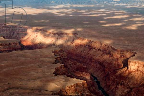 Aerial view of filtered light at sunrise over the Grand Canyon (photo)