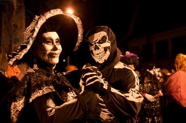 Costumed figures celebrate the Day of the Dead in Oaxaca, Mexico (photo)