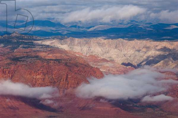 Aerial view of low clouds and rock formations in Zion National Park (photo)