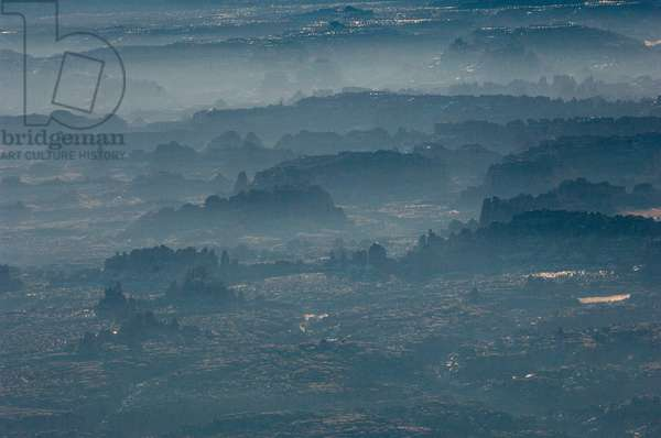 Aerial view of morning mist highlighting spires in the Needles (photo)