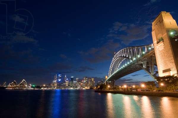 The Sydney Opera House, city skyline, and Harbour Bridge by night  (photo)