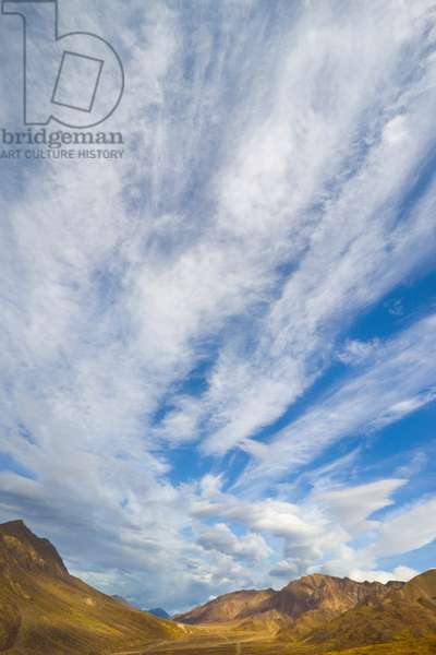 Cirrus and cumulus clouds over Alaska Range and golden fall tundra (photo)