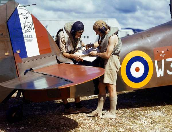 Pilots of the Royal Naval Air Station plot the course for a flight, Trinidad, 1942 (photo)