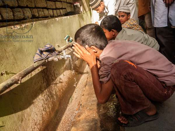 Muslim boys wash themselves at water spigots at an orphanage school in the village of Napa where Mahatma Ghandi passed through during his Salt March (photo)