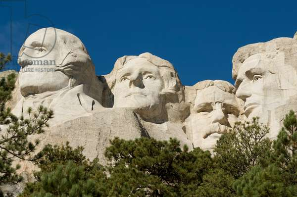Low angle view of the sculptures of presidents George Washington, Thomas Jefferson, Theodore Roosevelt, and Abraham Lincoln on Mount Rushmore (photo)