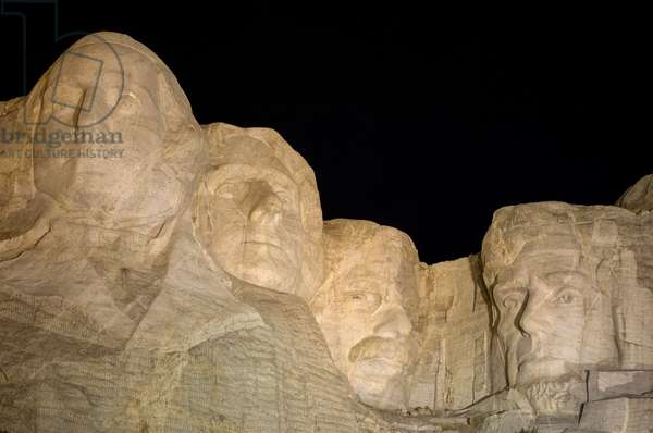 Low angle view of Mount Rushmore at night (photo)