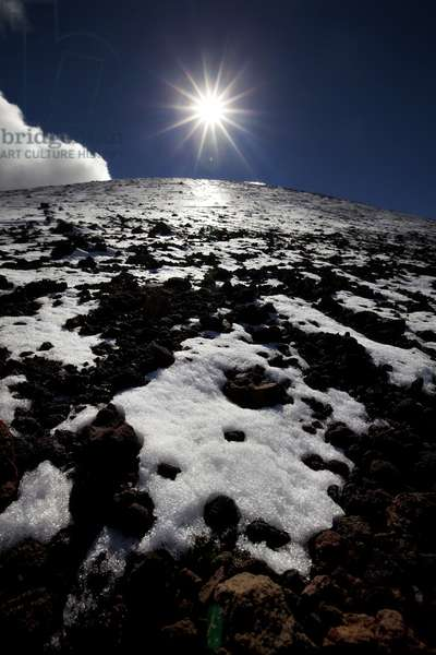 A light snow covers the lava rocks on Mauna Kea on the Big Island of Hawaii (photo)