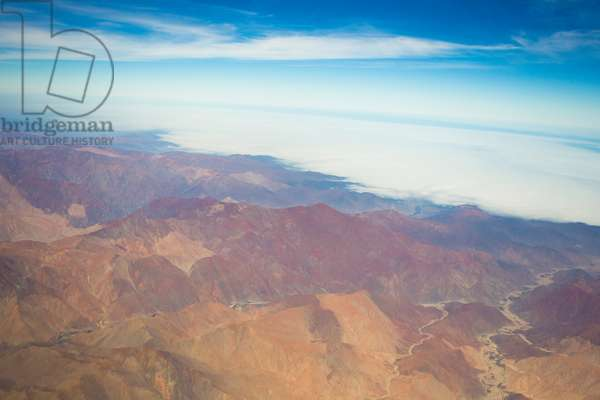 Aerial view of snow-less and dry section of the Andes mountains, Peru (photo)
