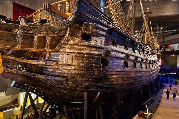 A salvaged 17th century sailing ship on display in the Vasa maritime museum (photo)