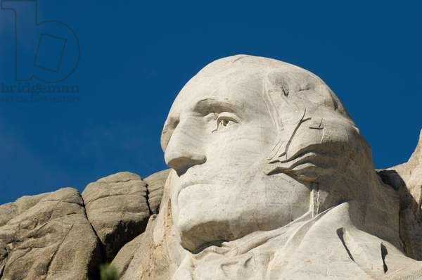 Low angle view of the sculpture of president George Washington on Mount Rushmore (photo)