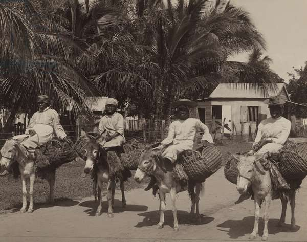 Four women use donkeys as a means of transportation around the island, Jamaica, 1922 (b/w photo)