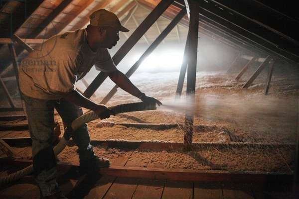 A house is weatherized with blown insulation in Houston (photo)