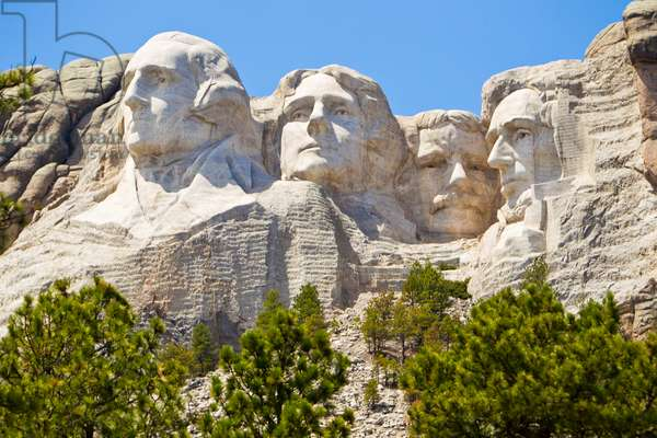 Low angle view of the sculpted images of American presidents Washington, Jefferson, Theodore Roosevelt, and Lincoln, at Mount Rushmore (photo)