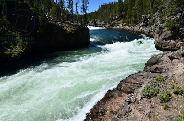 Water from the Yellowstone River rushes around a bend nearing the Upper Falls in Yellowstone National Park, Wyoming (photo)