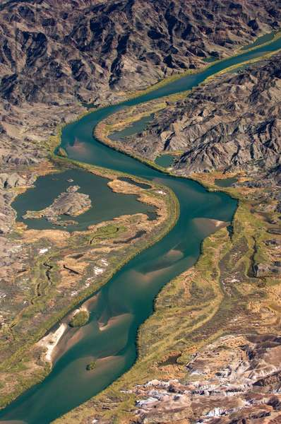 Aerial view of the Colorado River flowing through rugged terrain (photo)