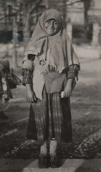 A little girl smiles for alms outside the Mosque of Sacta Sophia, Istanbul, Turkey, 1922 (b/w photo)