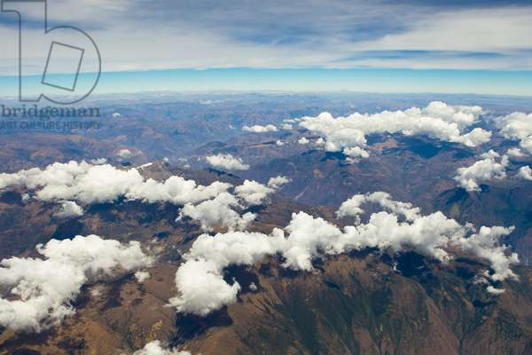 Aerial of clouds blanketing the Andes mountains in Peru (photo)