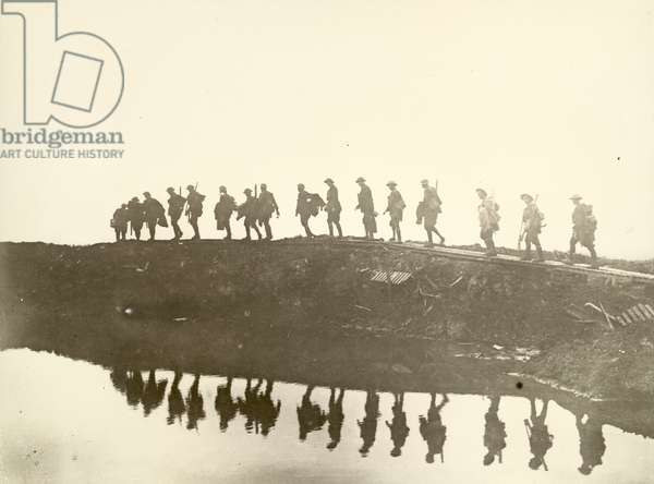 Supporting troops of the 1st Australian Division walking on a duckboard track, 1917 (gelatin silver print)