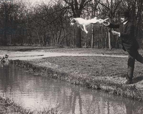 M. Pitt Teaching his Dog Tupy to Jump over a Brook, 1912 (gelatin silver photo)