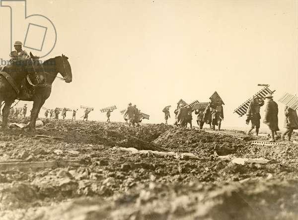 Pioneers of the 1st Australian Division preparing a duckboard track, 1917 (gelatin silver print)
